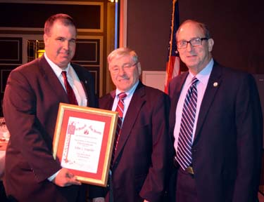 Photo of NJ State Board of Agriculture President Richard Norz and Secretary Fisher presenting Kupcho with his award