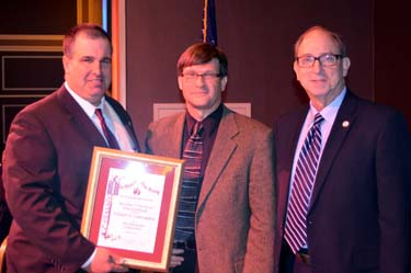 Photo of NJ State Board of Agriculture President Richard Norz and Secretary Fisher presenting Richard VanVranken with his award