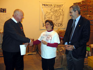 Photo of Secretary Kuperus giving Mercer Street Friends a grant check