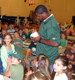 Photo of Adrien Clarke with students at Brielle Elementary School
