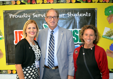 Photo of Secretary Fisher with Ceres School Principal Velez and Health Teacher Linda Kovalsky