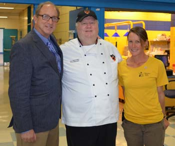 Photo of Secretary Fisher with Chef Dan Slobodien and farmer Jess Niederer