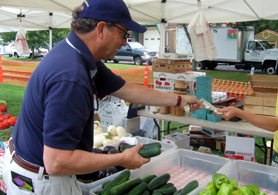 Secretary Fisher purchases produce at Woodstown Farmers Market - Click to enlarge