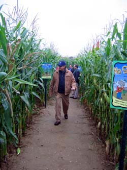 Photo of Secretary Fisher walking through VonThun corn maze