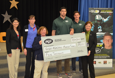 Photo of Glen Meadow Middle School officials accepting an award from the NY Jets