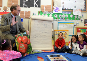 Secretary Fisher reading to 5 year old Head Start students - Click to enlarge