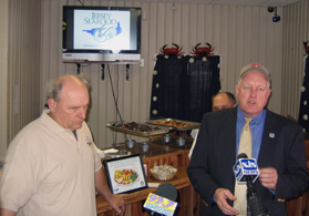 Photo of Jim Lovgren and Secretary Kuperus speaking about the benefits of the Jersey Seafood Branding Program - Click to enlarge