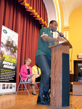 Photo of Bret Lockett speaking at the Passaic Eat Right, Move More Program