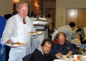 Photo of Secretary Kuperus serving lunch at Bethel Soup Kitchen - Click to enlarge