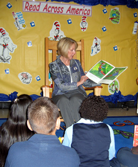 Photo of Pat Dombroski of USDA reading to students in Perth Amboy