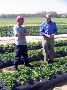 Photo of Secretary Kuperus with Brian Porch at his farm in Pedricktown