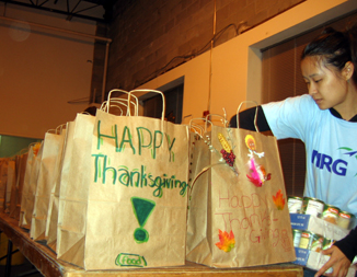 Photo of a volunteer packing grocery bags for the hungry