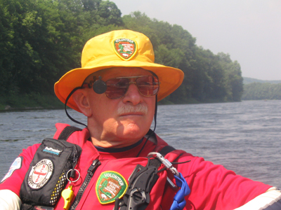 Image of Dick Rhodes providing safety on the Delaware River.