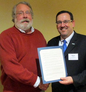 DRBC Executive Director Steve Tambini (right) presents a ceremonial resolution to Bob Molzhan (left) to congratulate him on his retirement. Photo courtesy of WRADRB member Dennis Palmer.