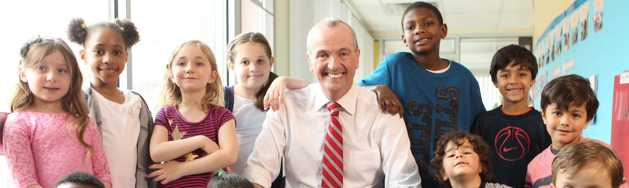 Photo: Phil Murphy with group of kids