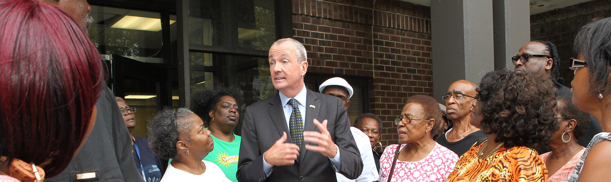 Photo: Phil Murphy talking to group of adults
