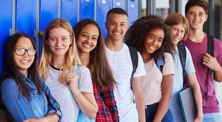 Photo: Group of students leaning on lockers
