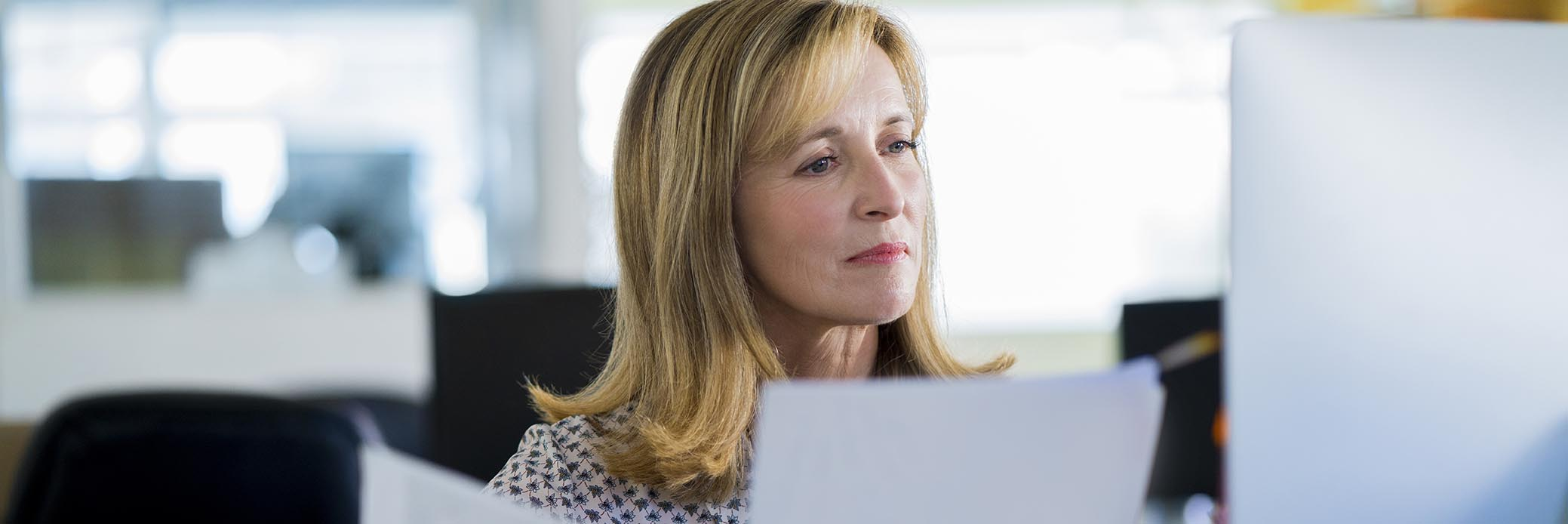 woman in office looking through papers