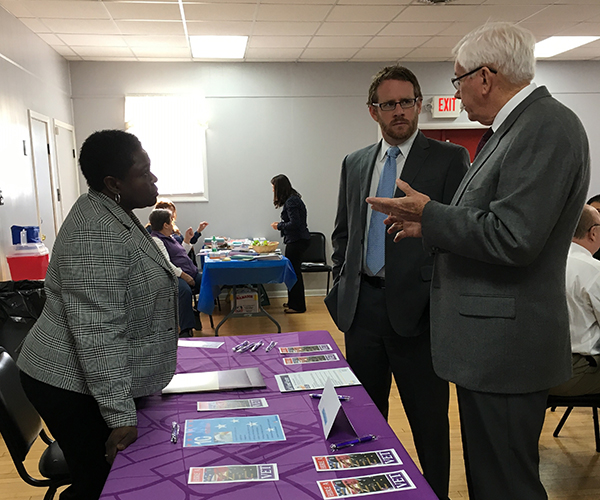 Labor Department Chief of Staff Gregory Townsend (center) discusses veterans services with Veterans Business Representative Veronica Jones and State Veterans Program Coordinator Wayne Smith at the Middlesex County Veterans Job and Services Fair.