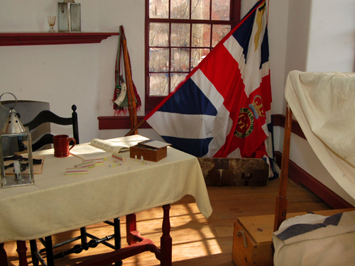 An officer's bedroom - The King's colors were donated to the Museum by Queen Elizabeth