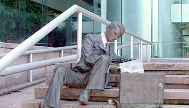 law- themed sculptures are scattered throughout the grounds of the Hughes Justice Complex