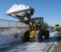 NJDOT Equipment Operator Scott Huda clears a bridge deck on Route 29 in Trenton following the first snowstorm of the season.